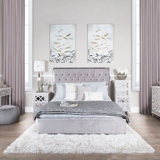 Grey King Size Bed With A Chrome Frame And Velvet Style Upholstery