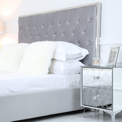 Grey Double Size Bed With A Chrome Frame And Velvet Style Upholstery